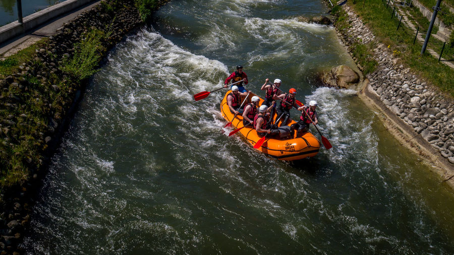 High angle view of men rafting in river