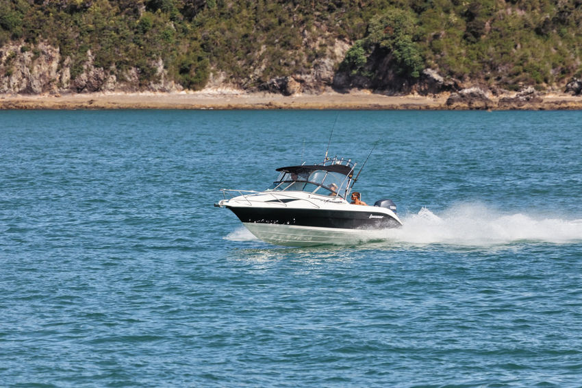 Speedboat with tourists in Bay of Islands, one of the most popular fishing, sailing and tourist destinations in New Zealand. Bay Of Islands Boating Couple Fun Paihia Racing Boat Transportation Vacations Aquatic Sport Beach Boat Cruising Motor Boat Nautical Vessel New Zealand People Sea Single Object Speed Speedboat Splashing Wake Water Yacht Yachting