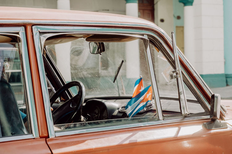 The Traveler - 2018 EyeEm Awards The Street Photographer - 2018 EyeEm Awards This Is Latin America Been There. Cars City City Life City Street Cuba Havana Road Taking Photos Walking Around Architecture Built Structure Car Close-up Enjoying Life Flag Land Vehicle Mode Of Transport Open Window Street Streetphotography Transportation Travel Destinations Vintage Cars Window