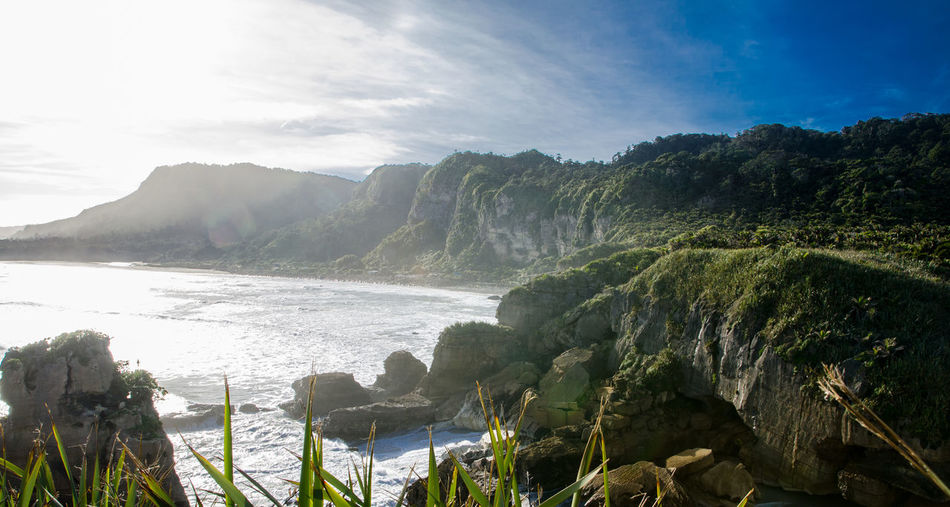 Tropical mountain view with seascape view at South Island, New Zealand. Beautiful Bright Cloud Earth Green Oceanside Sunlight Beach Blue Climate Coastal Lively Mountain Nature New Zealand Paradise Scenics Sea Sky South Island Summer Tropical Warm Water Waves