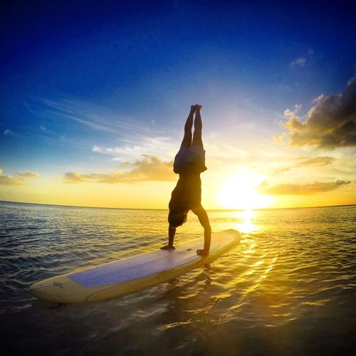 Adult Beach Beauty In Nature Cloud - Sky Day Handstand  Horizon Over Water Movement Nature One Person One Woman Only Outdoors Paddleboarding People Sand Sea Sky Sun Sunlight Sunset Surf Surfing Vacation EyeEmNewHere
