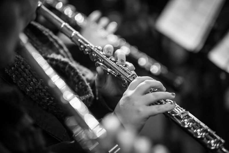Close-Up Of Person Playing Flute