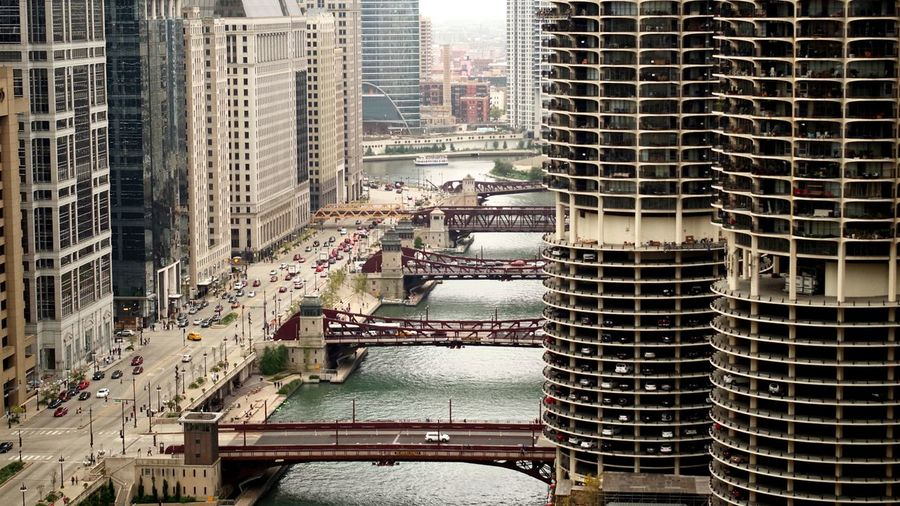 High angle view of drawbridges over chicago river amidst buildings in city