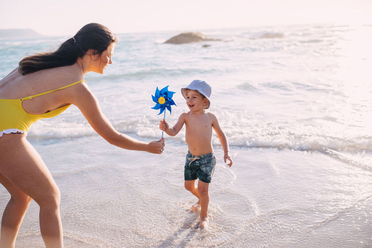 Child Childhood Beach Sea Land Family Water Togetherness Family With One Child Parent Bonding Nature Trip Holiday Offspring Leisure Activity Full Length Women Daughter Son