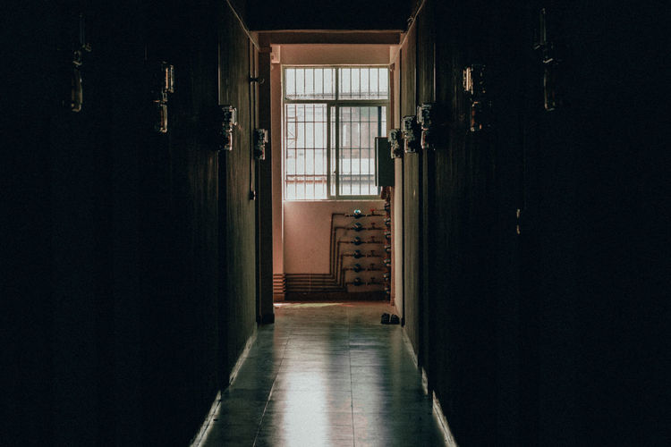 20.06.2017   looking at this photo reminds me of the environment working people go through for themselves or for family. this picture does not convey how it is in reality. Indoors  Building Architecture Door Entrance No People Arcade Corridor Built Structure Direction House Home Interior The Way Forward Domestic Room Absence Dark Open Day Empty Flooring The Traveler - 2019 EyeEm Awards