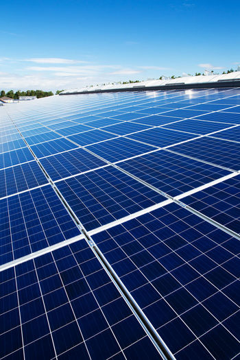 Many solar panels on a roof. Nice weather Roof Rooftop Solar Panel Alternative Energy Blue Blue Sky Energie Energiewende Energy Industry No People Renewable Energy Solar Energy Solar Energy Plant Solar Panels Solar Power Station Solarpanels Sunpower Sunshine
