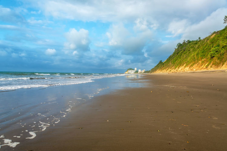 Long stretch of beach next to green hills in Same, Ecuador Architecture Beach Beauty In Nature Cloud - Sky Day Ecuador Horizon Over Water Landscape Nature No People Ocean Outdoors Pacific Pacific Ocean Same  Sand Scenics Sea Sky South America Tourism Travel Travel Destinations Vacations Water