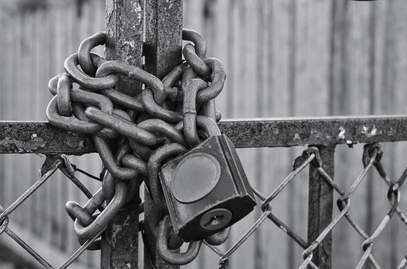 EyeEmNewHere Secure Lock Up Detained Trapped Old Contrast No People Conceptual Chain Strength Protection Lock Metal Gate Security Close-up Padlock Love Lock Locked Fence Attached Chainlink Worn Out Weathered Closed The Still Life Photographer - 2018 EyeEm Awards