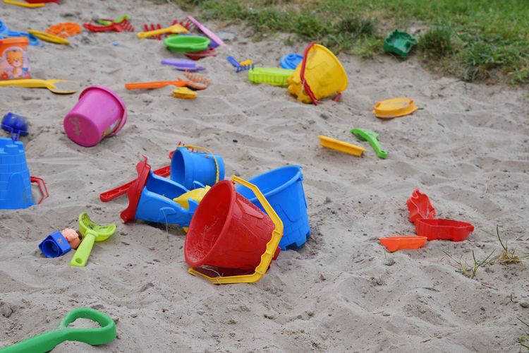 Sandbox wth colorful toys, close up background Fun Sandbox Sandboxlife Toys Vivid Beach Bucket Childhood Colorful Container Day Game High Angle View Land Large Group Of Objects Multi Colored Multicolored Nature Outdoors Plastic Playground Red Sand Toy
