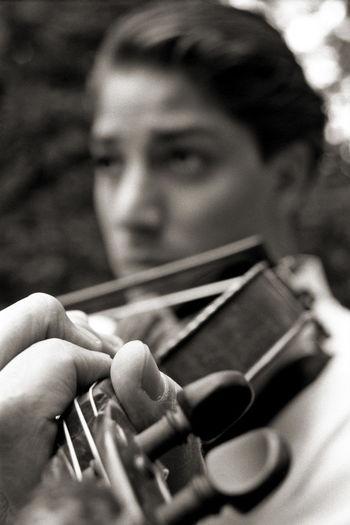 Close-up of man playing violin