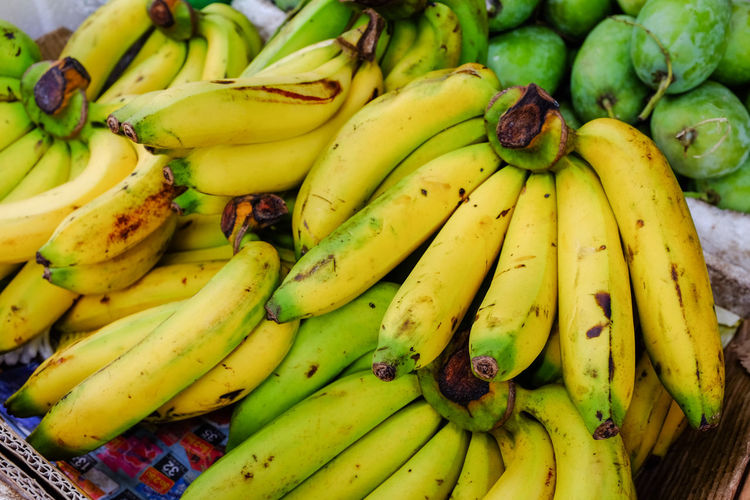Banana sold on fruit stall in Thailand. Tropical Fruits Banana Close-up Day Food Food And Drink Freshness Fruit Fruit Stall Healthy Eating Large Group Of Objects No People Yellow