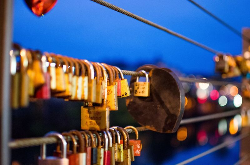 Hanging Padlock Focus On Foreground Close-up Metal Cable Lock No People Safety Sky Connection Positive Emotion Security Love Protection Love Lock Built Structure Emotion Railing Architecture Outdoors