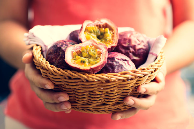 Fresh passion fruit in a basket holding by hand Basket Diet Eating Exotic Food Fresh Freshness Fruit Giving Half Hand Harvest Health Healthy Holding Ingredient Juicy Natural Nutrition Organic Passion Ripe Seed Tropical Food And Drink Midsection Close-up Lifestyles Healthy Eating Passion Fruit