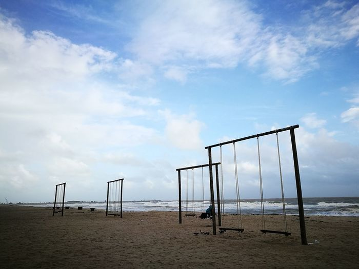 Beach and swings... Sand Beach Sky Outdoors Nature Day Breeze Clouds And Sky Terengganu Vacations Scenics Nature Beauty In Nature Cloud - Sky Sea Malaysia Beach Photography Beach Time Beachside Beachview BEACH!  Swings Swings With A View Kuala Terengganu Malaysia Scenery