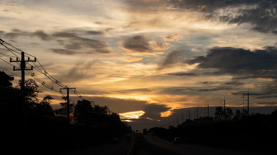Cloud - Sky Sky Sunset Electricity Pylon Silhouette Cable Electricity  Transportation Power Line  Nature Connection Beauty In Nature Scenics - Nature Road Technology Telephone Line New Horizons Horizon Sunrise Sundawn Cloud Scape Dramatic Sky Morning Early Morning No People