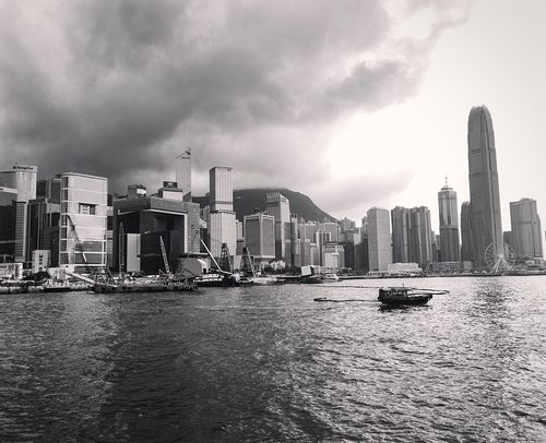 The wonderful view from the convention centre. It was also the place where the handover ceremony to China took place on the 30th of June 1997. HongKong Waterfront Water City Cityscapes Architecture Building Building Exterior Monochrome Blackandwhite Skyline Skyscrapers Urbanphotography Urbex IPhoneography Exploring New Ground Travel Photography Skyscraper Urban Landscape Buildings