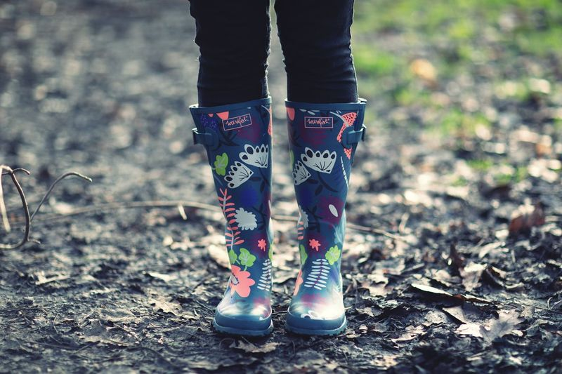 Wellies in mud Lifestyles Muddy Boots Walking Trail Wellington Boots Wellies  Shoe Body Part Human Body Part Standing One Person Women Leisure Activity Lifestyles Nature Fashion