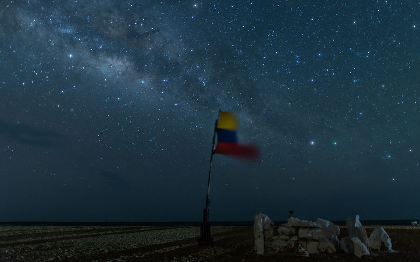 Colombia Astronomy Beauty In Nature Constellation Field Flag Galaxy Infinity Land Long Exposure Milky Way Nature Night No People Non-urban Scene Outdoors Scenics - Nature Sky Space Space And Astronomy Star Star - Space Star Field Tranquil Scene Tranquility