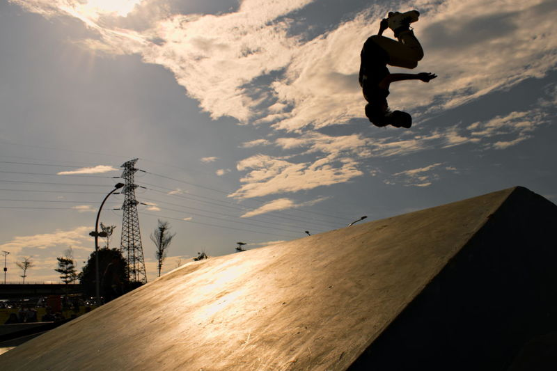 Low Angle View Of Silhouette Man Skateboarding Against Sky During Sunset