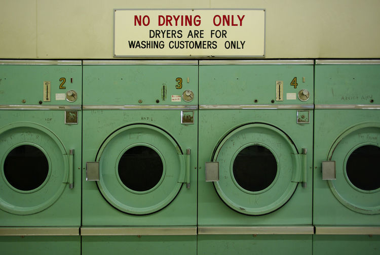 Full frame shot of dryers with text
