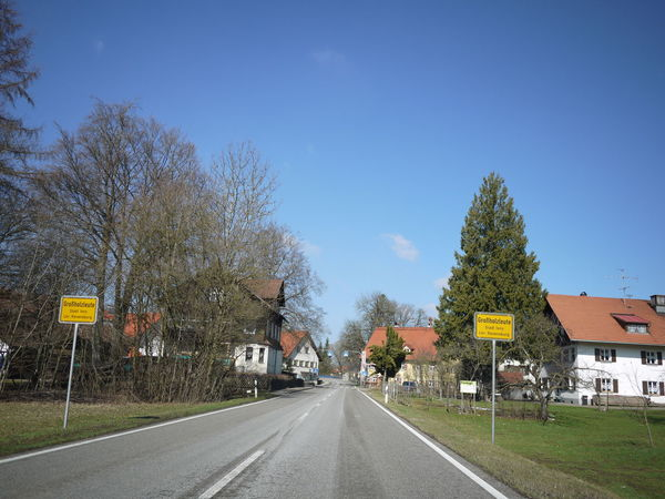 Trafficsign in south Germany Allgäu Guiding Traffic Bare Tree Beauty In Nature Clear Sky Day Diminishing Perspective Guidance Guide Nature No People Outdoors Road Road Sign Sky The Way Forward Traffic Sign Transportation Tree