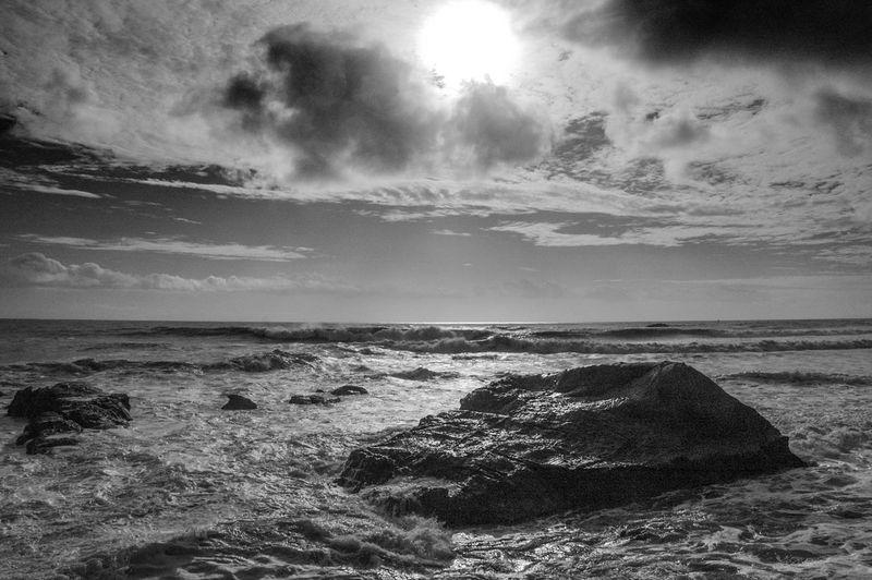 Rock, sea, sky.