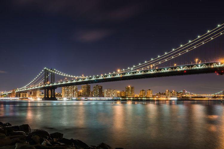 Illuminated manhattan bridge over east river