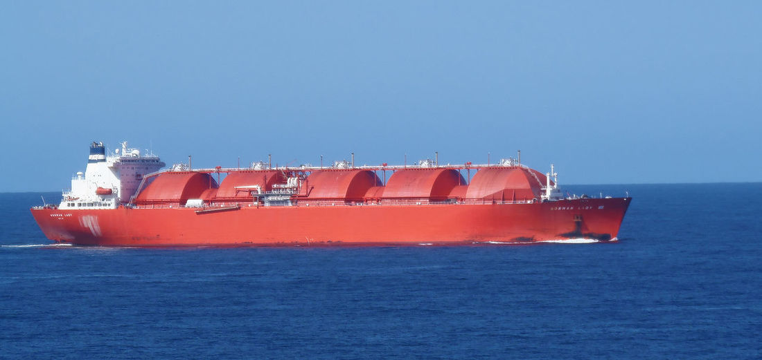 The Liquid Natural Gas tanker 'Norman Lady' on the high seas LNG LNG Tanker Norman Lady Ship Blue Cargo Container Clear Sky Day Freight Transportation Industry Liquid Natural Gas Mode Of Transport Nature Nautical Vessel No People Outdoors Red Sea Shipping  Shipping  Sky Transportation Transportation Of Gas Water