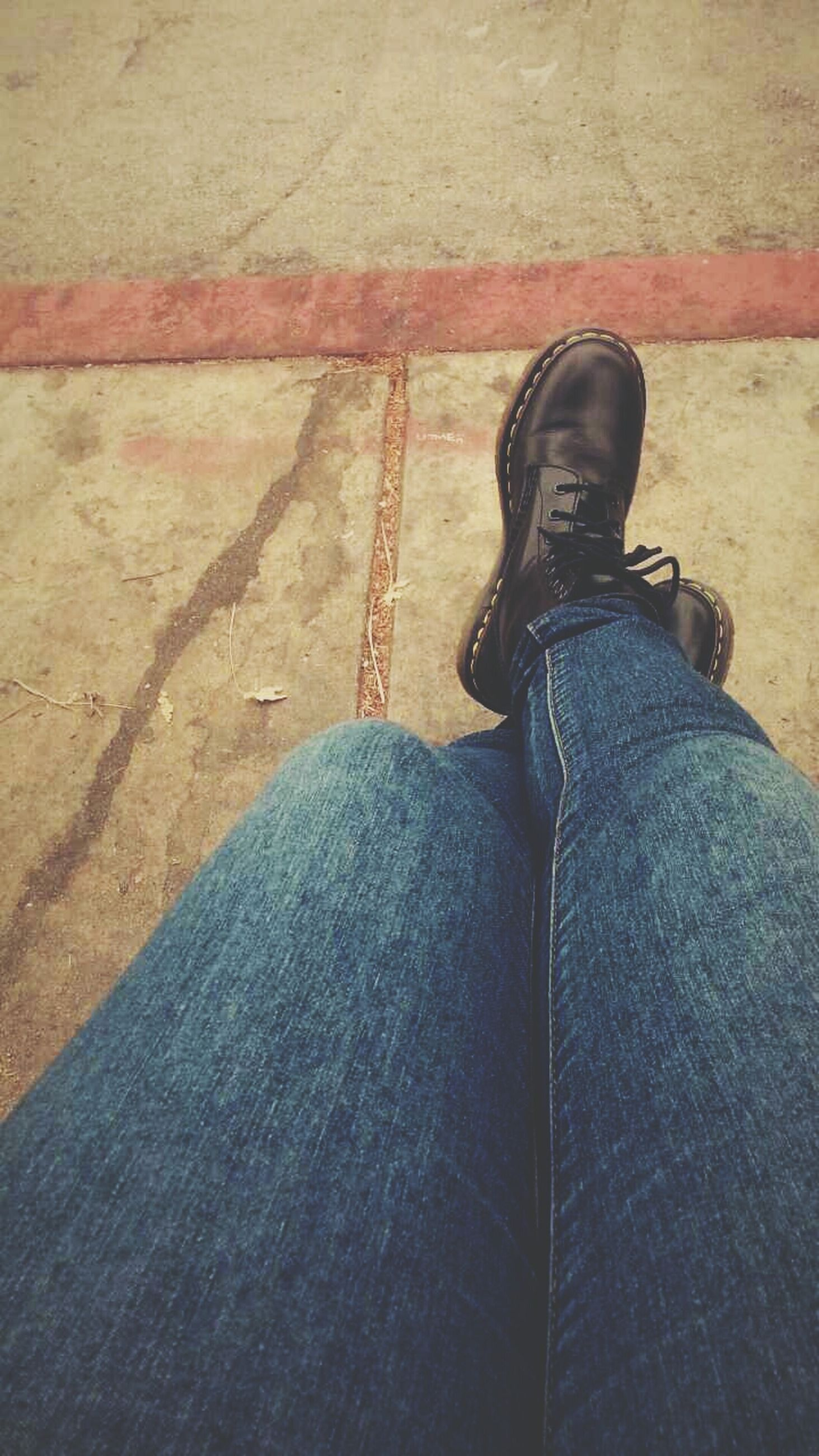low section, person, shoe, personal perspective, jeans, lifestyles, standing, high angle view, human foot, men, footwear, leisure activity, casual clothing, unrecognizable person, shadow, sunlight, sitting