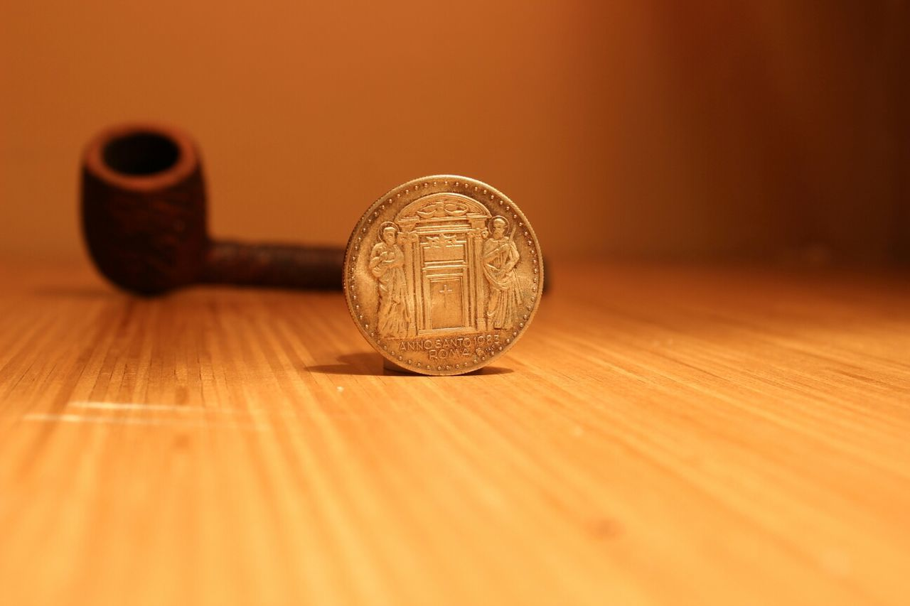 Close-up of coin on table