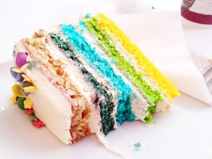 Close-up of colorful cake slice on table