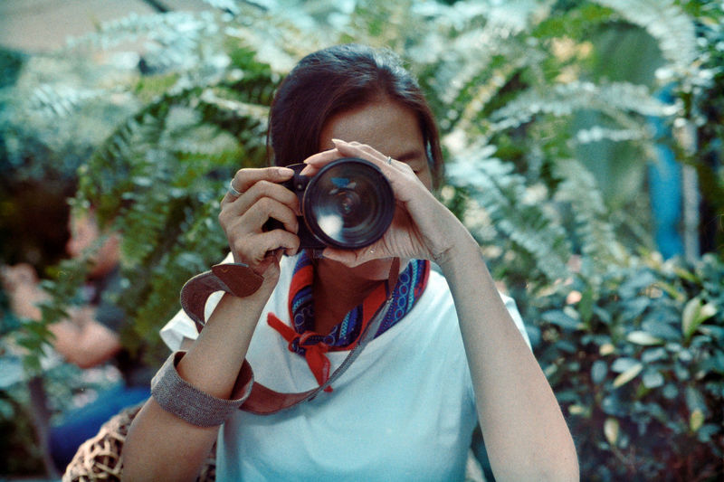 Portrait of woman photographing