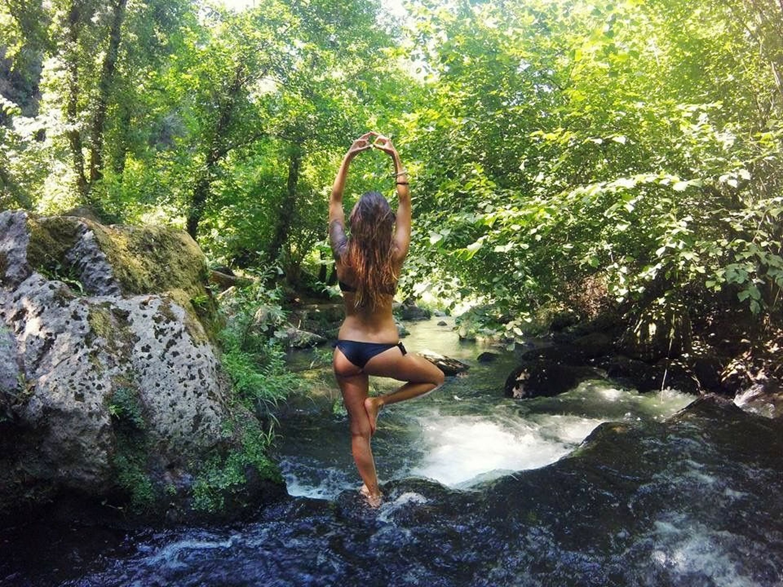 one person, rock, real people, rock - object, solid, young women, tree, plant, lifestyles, water, young adult, beauty in nature, nature, forest, leisure activity, hairstyle, women, hair, flowing water, outdoors