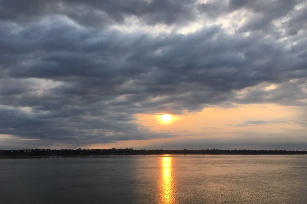 sunset, sky, beauty in nature, cloud - sky, scenics, nature, tranquility, tranquil scene, atmospheric mood, dramatic sky, idyllic, sun, no people, reflection, water, outdoors, day
