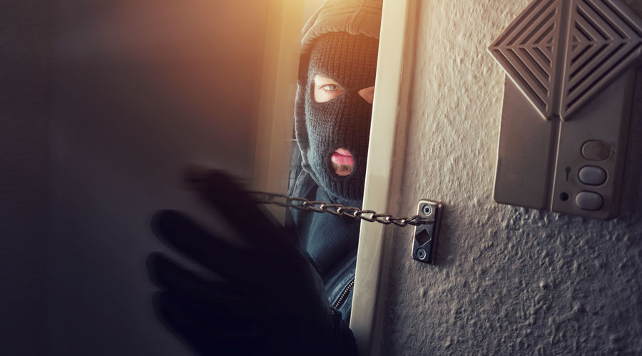Burglary breaks in to a house with door chain Adult Alarm Burglar Burglary Close-up Crime Crime Scene Criminal Door Chain Ganster Hoodie House Door Human Body Part Human Hand Human Hands Indoors  Justice Law Masked Motion Night One Man Only One Person Only Men Real People