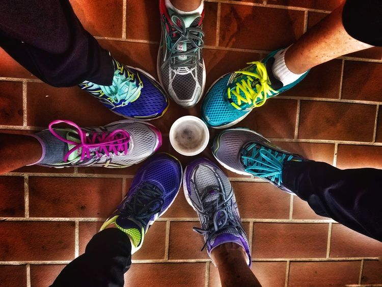 Celebratory beverage with friends after the annual Yuengling light Lager jogger 5k Run Out Of The Box Low Section Togetherness High Angle View Standing People Human Body Part Human Leg Adult Day Multi Colored Adults Only Men Sneakers Will Run For Beer Close-up Outdoors Friendship Only Men