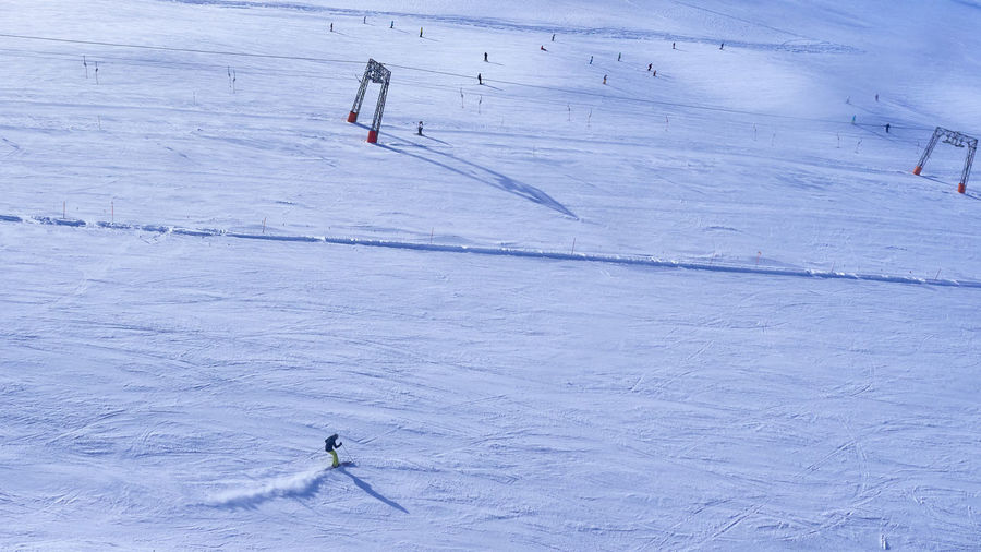 High Angle View Of Person Skiing On Snow Covered Landscape During Winter