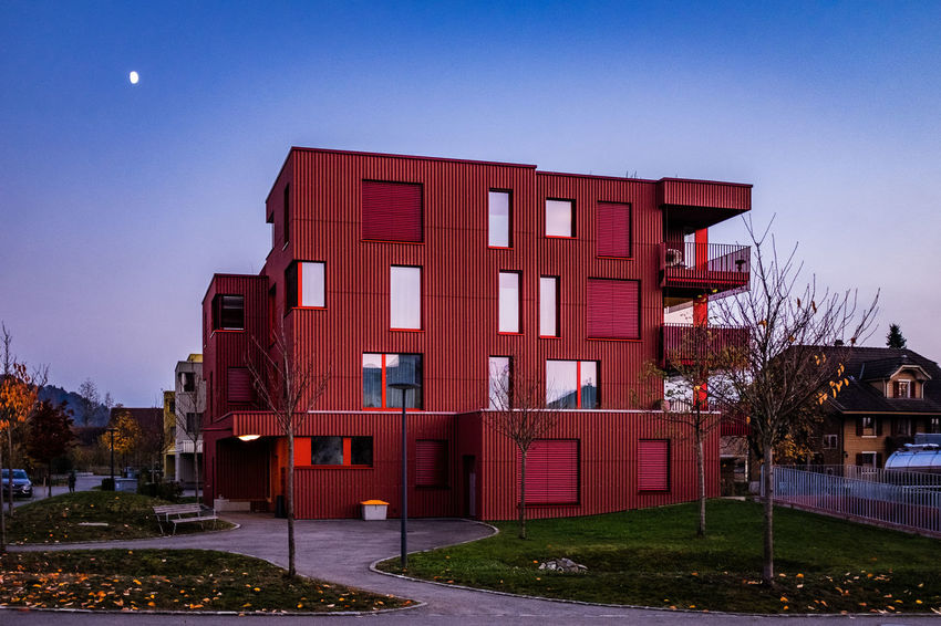 Architecture Built Structure Building Exterior Sky Building Nature Clear Sky No People City Plant Residential District House Red Window Day Blue Outdoors Tree Grass Copy Space Row House