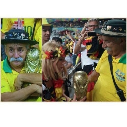 Sad Brazilian fan gives his fifa world cup 2014 trophy to a German fan as they beat brazil Respect Massiverespect Germany Brazil