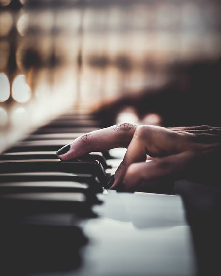 Cropped Hand Of Woman Playing Piano