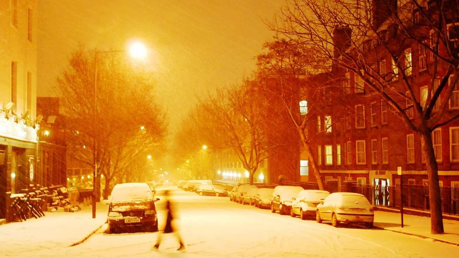 Cars on street in winter at night