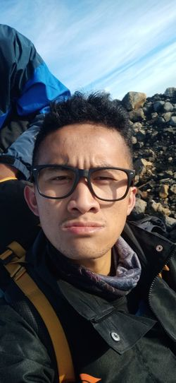 Portrait of smiling boy wearing eyeglasses