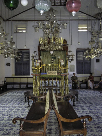The pulpit of the historic Jewish synagogue in Cochin. The synagogue is located in the older part of the city, and is a very old construction, with the earliest version of the historic structure dating back to the earlies arrivals of Jews to Kerala millenia back. Unfortunately, the number of jews in Cochin is very few right now, with many having emigrated to Israel. Architecture Cochin Cochin Synagogue India Indoors  Jewish Synagogue Synagogue In Cochin