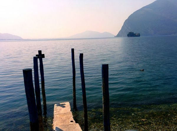 Sea Water Nature Tranquility Tranquil Scene Beauty In Nature Mountain Outdoors No People Day Lake Lake View Italy Relaxation Tranquility Landscape Scenics Travel Destinations Vacations Cityscape City Travel Sky Illuminated Summer
