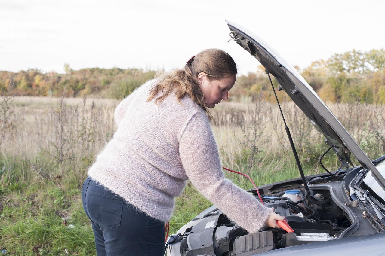 Woman Fixing Car