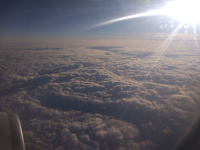 Cloud - Sky Sky Beauty In Nature Scenics - Nature Sunlight Aerial View Air Vehicle Sun Mode Of Transportation Airplane Flying Nature Cloudscape Lens Flare Transportation Sunbeam No People Day Tranquil Scene Outdoors Softness Bright Meteorology