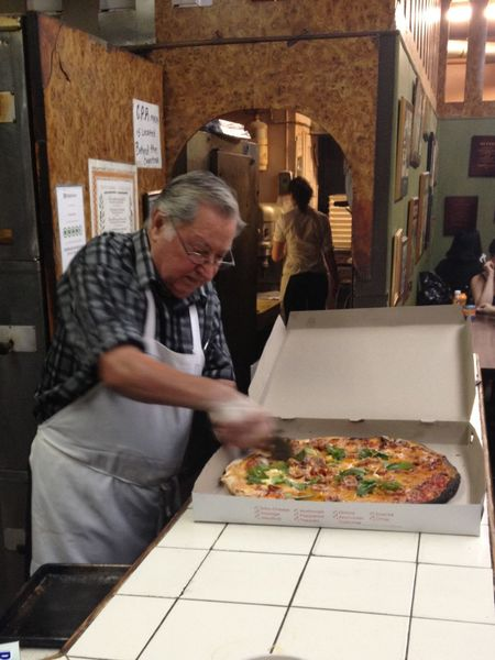Best pizza in the city Di Fara Dom Indoors  Senior Men Pizza Food And Drink Food Preparation  Standing Real People Apron Senior Women Two People Men Leisure Activity Freshness Eyeglasses  Togetherness Adults Only People Adult