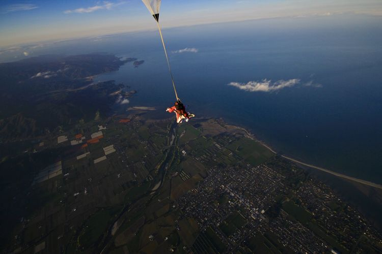 High angle view of man paragliding in mid-air