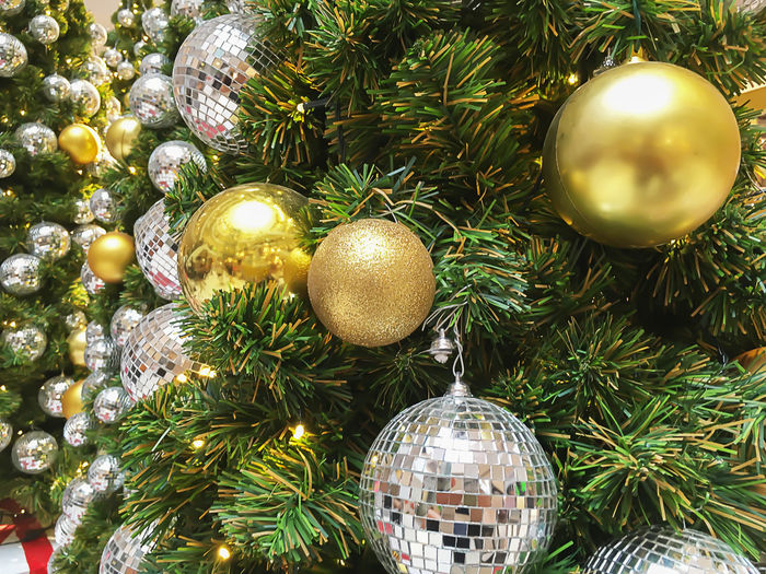 Christmas Celebration Christmas Decoration Holiday Christmas Ornament Decoration christmas tree Sphere Holiday - Event Celebration Event Tree Event Shiny Christmas Lights Close-up No People Indoors  Gold Colored Illuminated Silver Colored Golden Balls