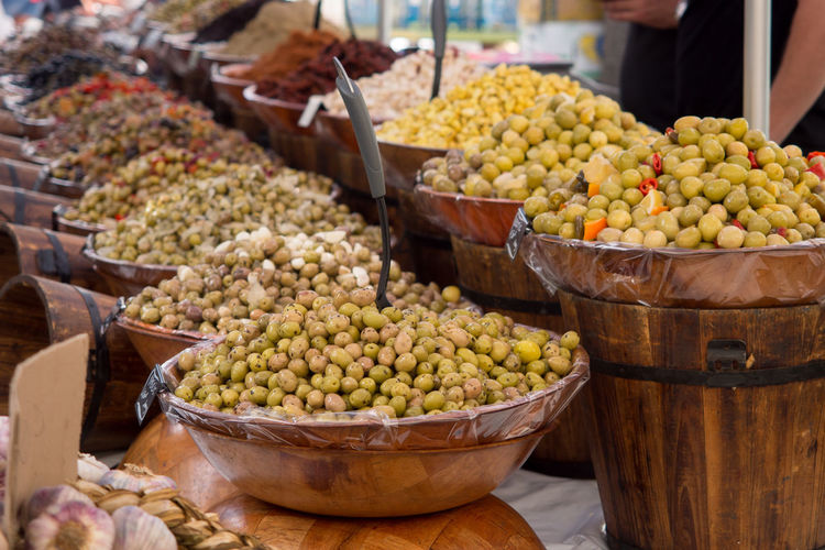 Close-up of various olives for sale at market stall